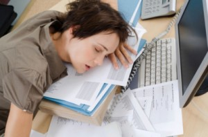 Woman sleeping at desk. B04G6F